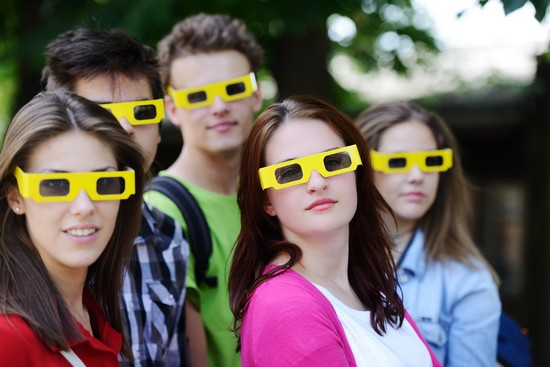 women gasping while wearing 3d film glasses